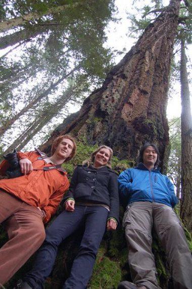 Backing against a giant Douglas fir in Francis King Regional Park